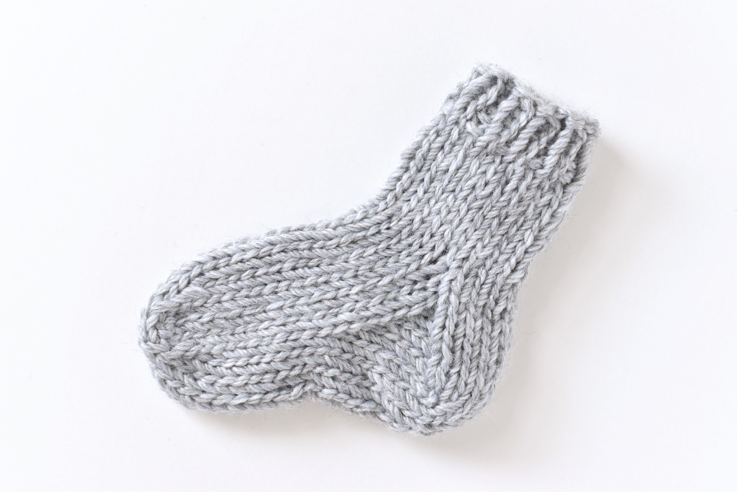 Free Knitting Patterns For Socks On Four Needles Knit A Small Sock With A Step Step Practice Pattern