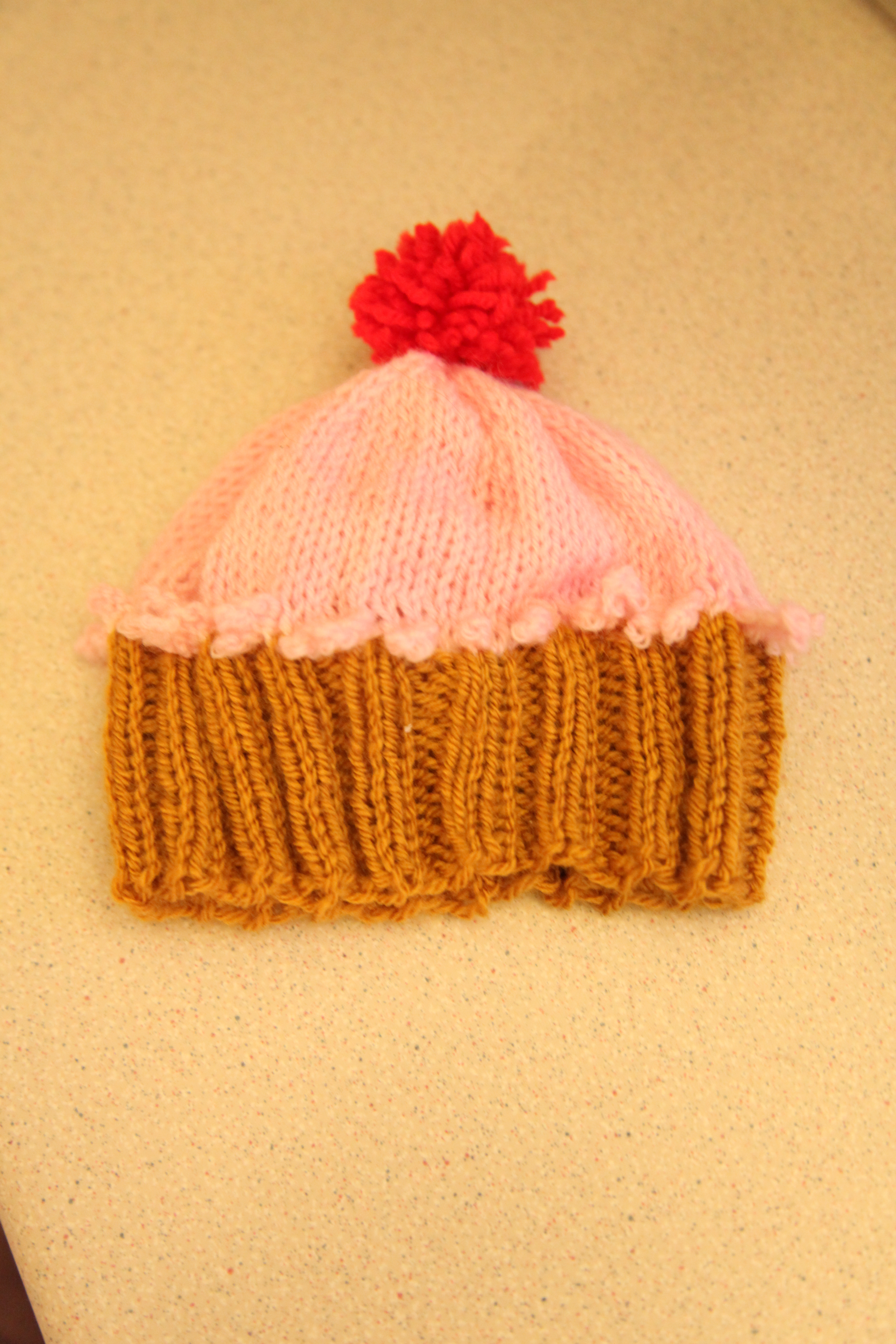 Knitted Cupcake Hat Pattern Cupcake Hat The Cherry On Top Of Free Patterns Just Another Knitter